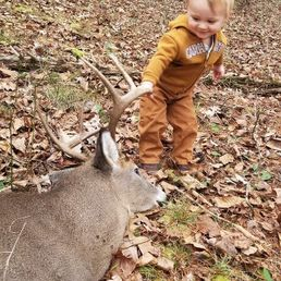 Easton with deer - Drew Baggarly