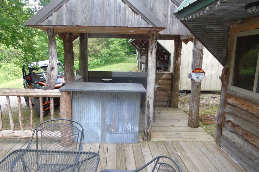 Grill and cook area on porch of office, store