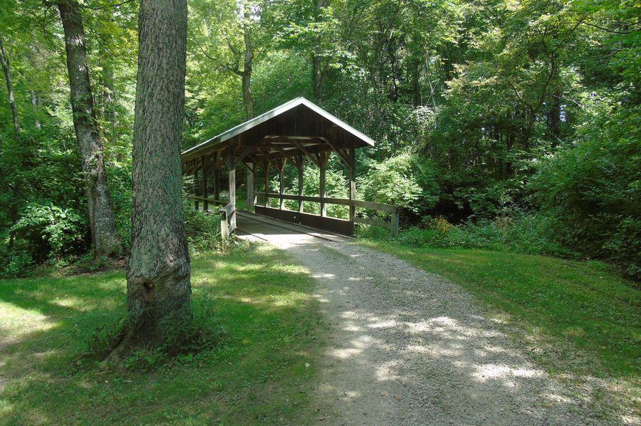 Covered bride crossing big creek. huge concrete footings w steel beams as support