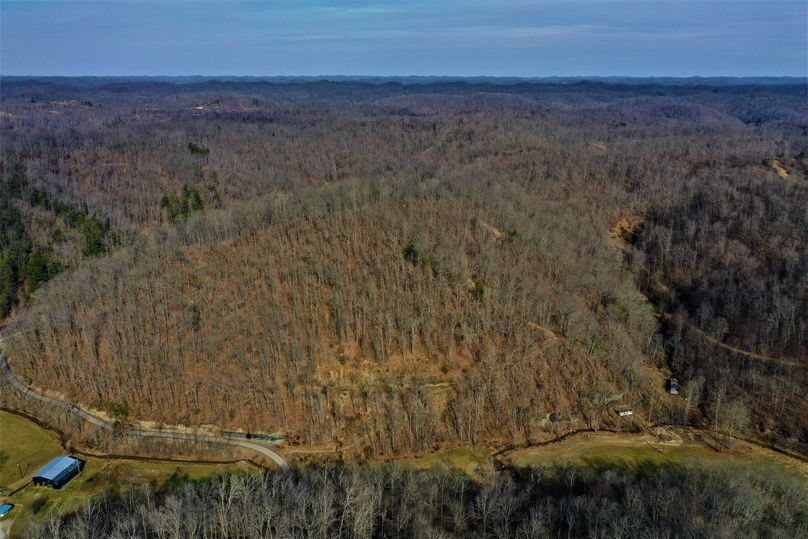 033 aerial drone shot looking east over the property