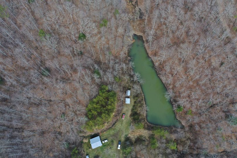 021 aerial drone shot of the home, garage, storage building and pond