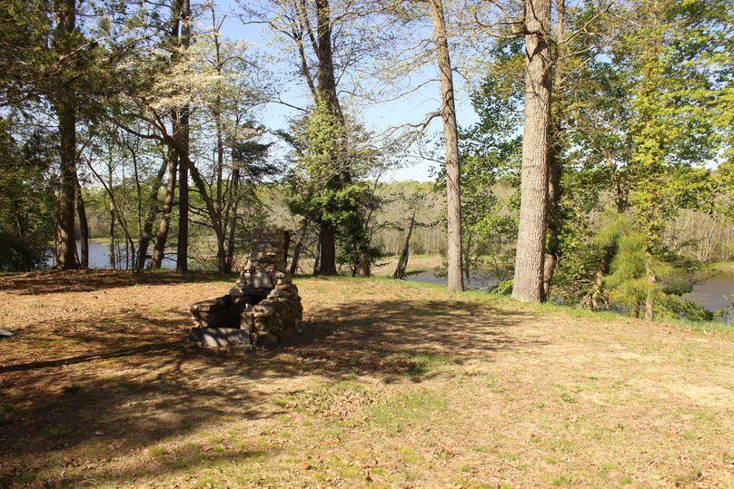 63.44acres carolinecty backyard backyard fireplace
