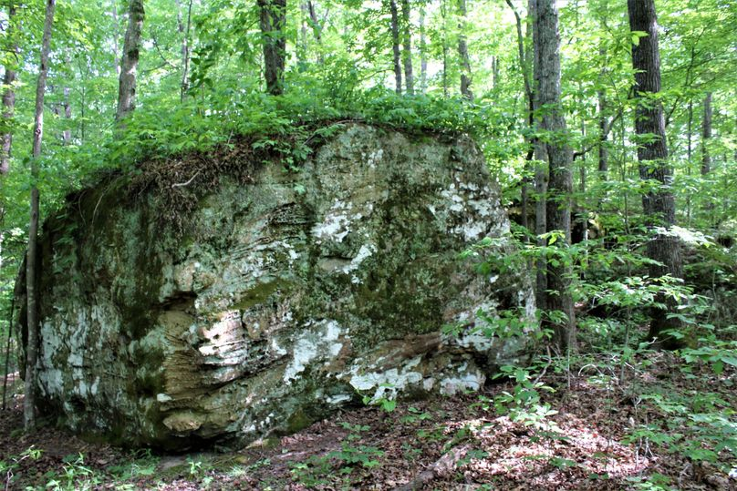 014 huge boulder sitting atop a point, look closely at the base of the rock on the left side