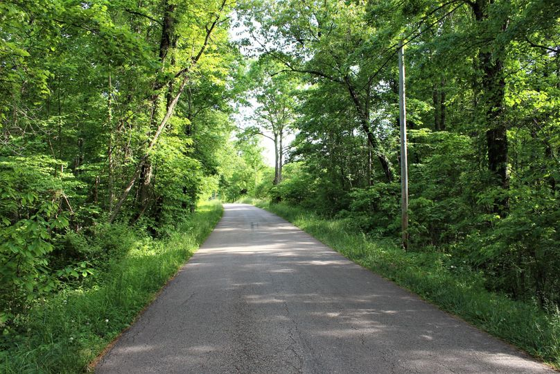 027 county blacktop road along the south boundary of the property