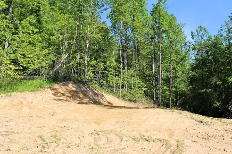 003 graded opening near the entrance of the property, perfect for a home, cabin or rv site