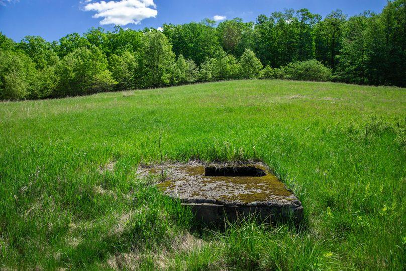 11  open well near barn foundation. please be aware.