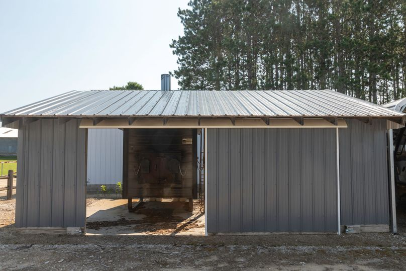 18 wood furnace boiler provides radiant floor heat to welding shop migrant house 1 and the farm house