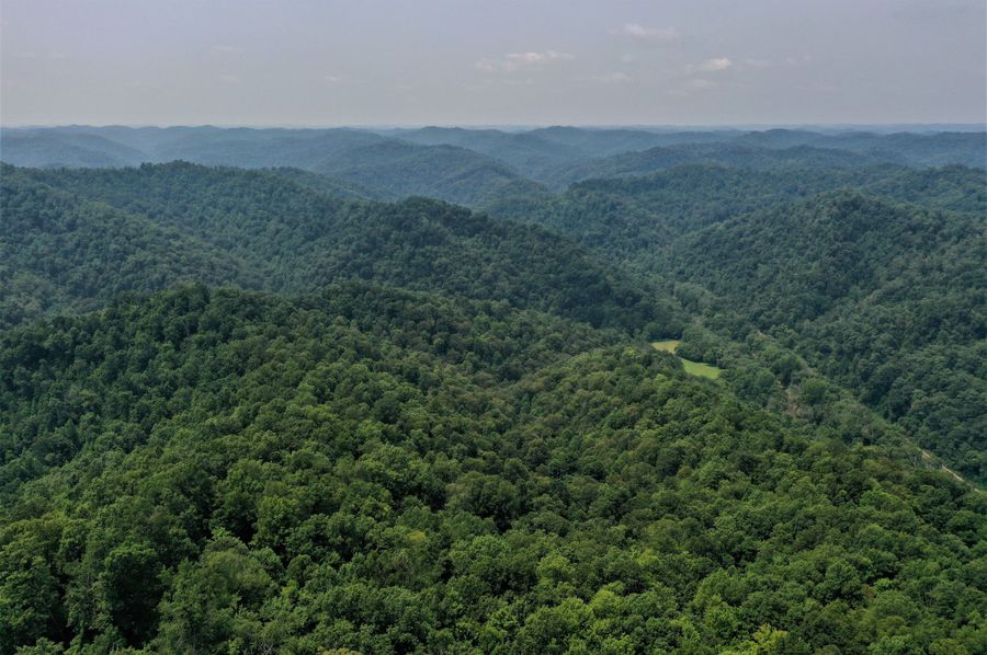 007 aerial drone shot from the center of the property looking northeast down the valley