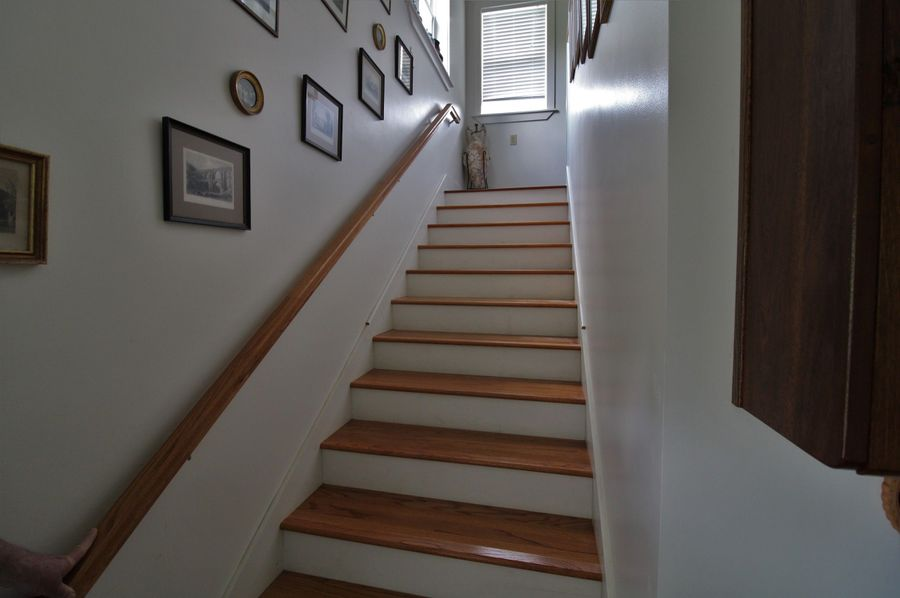 043 heading upstairs to master bed and bath