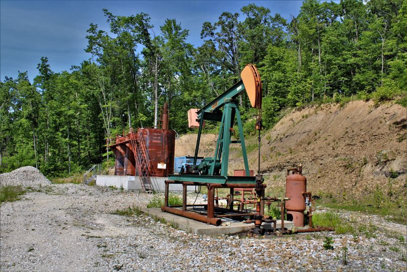 055 gas and oil well on property