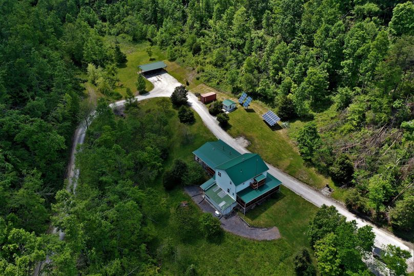 001 beautiful aerial view of the homestead, solar panels, and storage shed