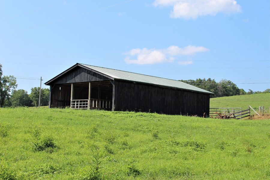 003 the feed barn along the road and north edge of the property