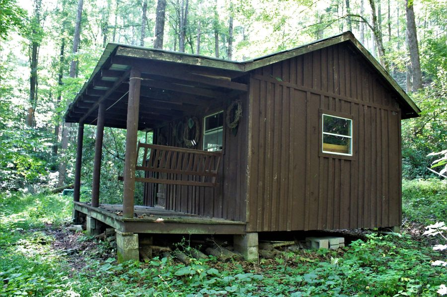 013 the small cabin sitting back in the woods in the south portion of the property