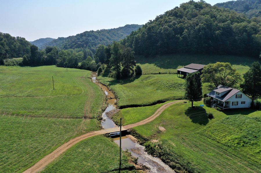 037 aerial drone shot at low to mid elevation looking east up the creek